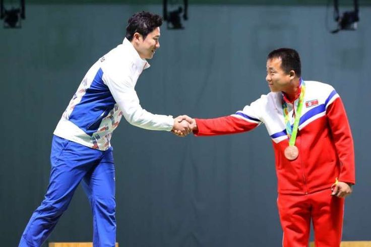 Olympic shooters from both Koreas shakes hands during the medal ceremony. Next meeting at the DMZ.