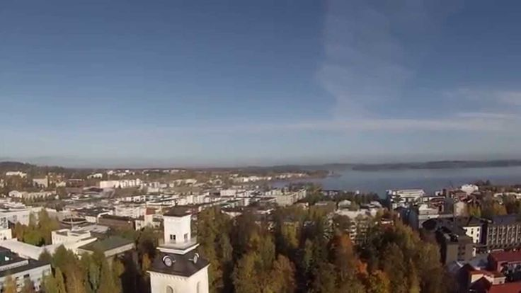 Aerial video over the pedestrian streets in the city centre and beside the Puijo tower, Kuopio, Finland.