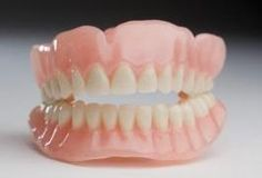 In addition to daily denture cleaning, you may find the need for a denture-whitening product to help remove coffee, tea, berry or other stains. Particularly after prolonged use, dentures may need a thorough cleaning periodically to restore their pearly white luster. When mild soap isn't enough to get your dentures clean, try a home remedy to whiten...