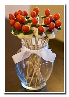 Edible Italian Centerpiece...buffalo mozzarella, cherry tomatoes , basil leaves For Death by Dessert? :O...