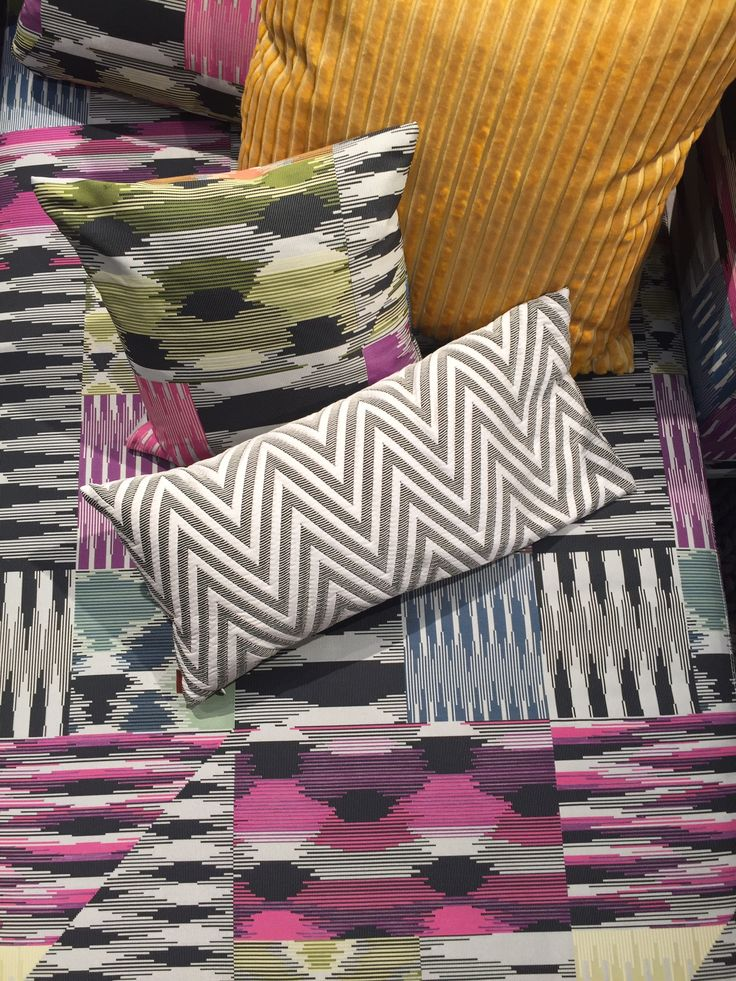 Throw pillows by MissoniHome, featuring the Patch Di Fiammati collection. The neutral colors on the zigzag pillow allow the very different patterns to complement each other.