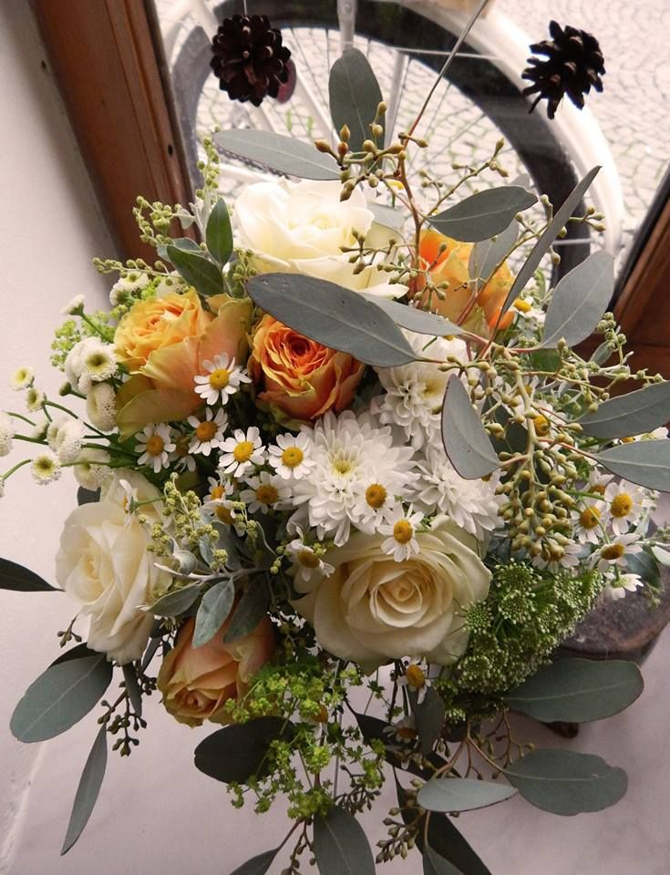 silver and gold bouquet with avalanche roses, matricaria, alchemilla and eucalyptus