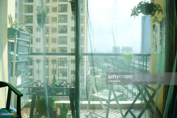 From the balcony is a glimpse of Jakarta (Indonesia) aerial view in the afternoon. The furniture are made of sustainable material (resource) and recyclable.