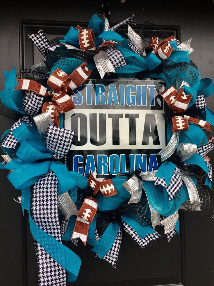 A personal favorite from my Etsy shop https://www.etsy.com/listing/474314775/carolina-panthers-nfl-football-wreath