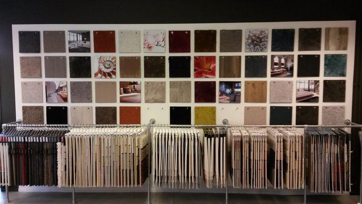 Onze wand met tapijt- en vinylstalen in Hellevoetsluis!