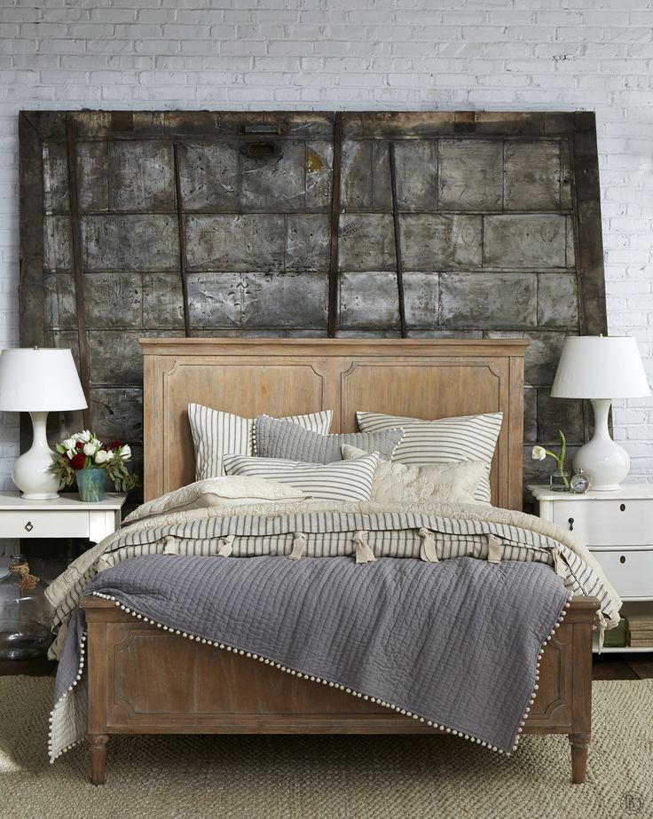 Ballard Designs- Industrial loft-style bedroom with ticking stripe bedding and…