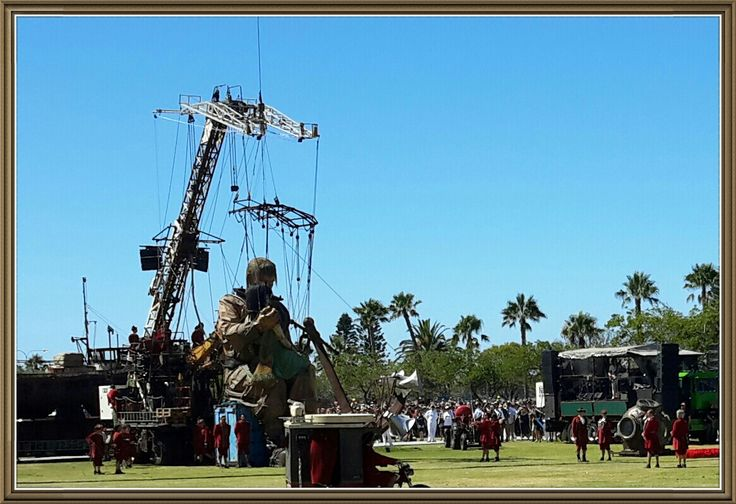Giant marionette Diver sitting with little girl on a Sea Container before his helmet goes on. Langley Park - Anzac Memorial celebration. Perth WA Feb 2015