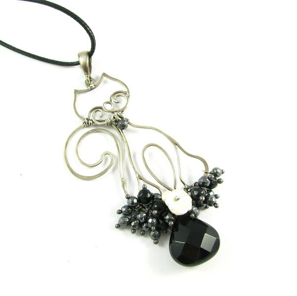 Silver pendant with unch of dangling minerals by Pillow Design