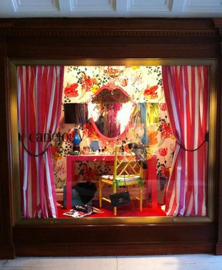 Curtains, a vibrant wallpapered backdrop, & perfect lighting for a jewel-box of a display window for any furniture resale shop! More ideas at http://TGtbT.com