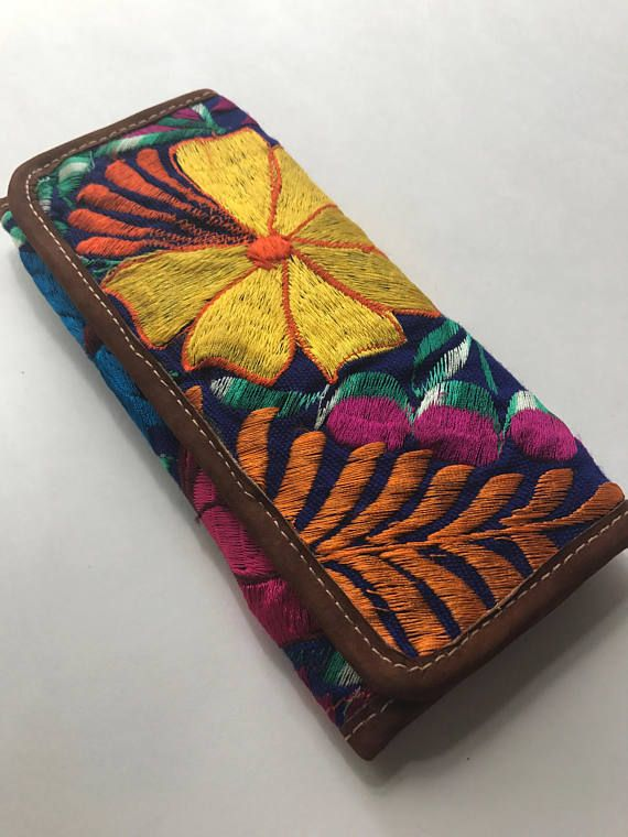 Mayan Leather Floral Huipil Clutch Wallet from Marula Market.   20% of profits will help build a rescue center in Poptun, Guatemala!