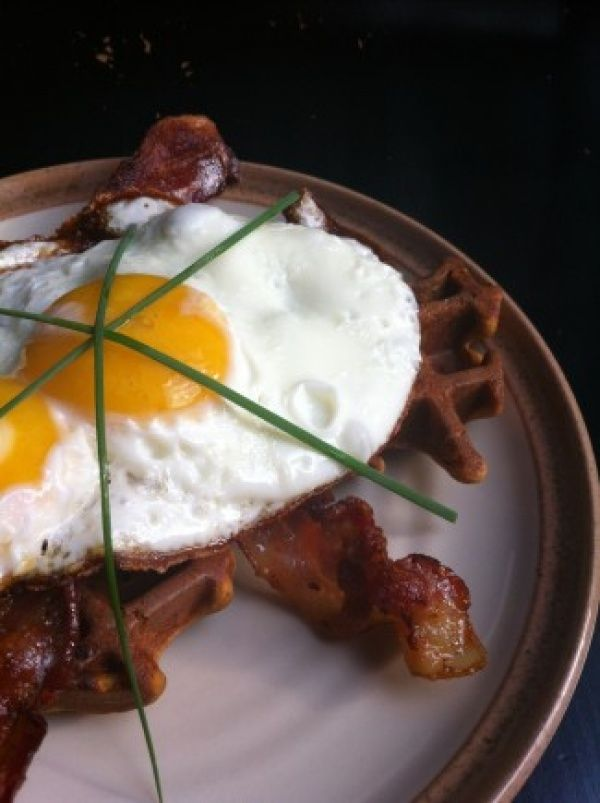 Easy savory paleo waffle recipe, great for grab and go or as a perfect base for a saucy meal. Uses fresh produce- a perfect way to plow through all the zucchini you've been growing!