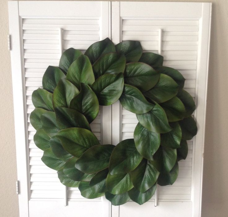 "Faux magnolia wreath, fixer upper style wreath, 18"" magnolia wreath by MorgansMarketDesigns on Etsy https://www.etsy.com/listing/399376875/faux-magnolia-wreath-fixer-upper-style"
