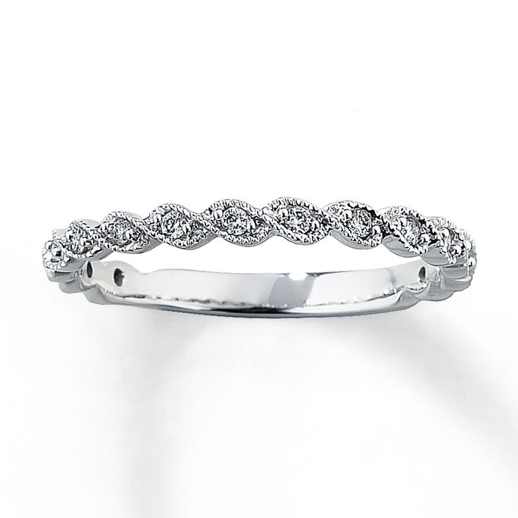 14K White Gold 1/8 Carat t.w. Diamond Anniversary Band  My wedding band. Love love love it. Like waves of the ocean and fits right up under my halo-style engagement ring.   This type of design is great if you're looking for something that fits against your engagement ring that isn't a set piece (in case you want the more stacked look) and isn't set high.  I can wear it by itself and it doesn't get in the way with my hands-on job.  It's so beautiful, delicate, and antique-y.