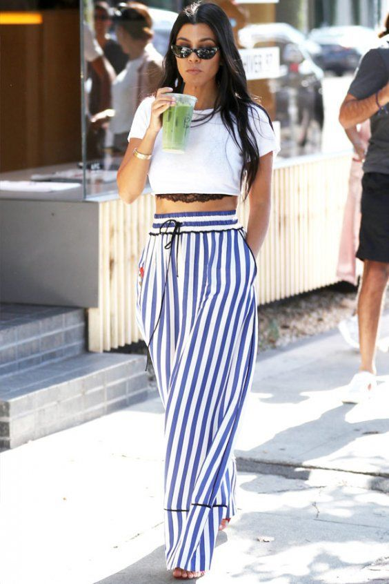 6aa0c3d0972 Kourtney Kadashian is a lover of palazzo pants and looks great in these  blue stripes and cropped white tee. | 6 Style Tips On How To Wear Palazzo  Pants