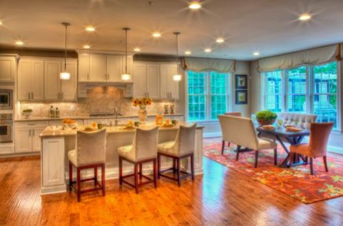 Photo of the Remington Place luxury home kitchen and dining room built by Heartland Luxury Homes.