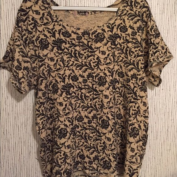 Black floral dressy top This is a great shirt for anywhere! It is light and flows out at the bottom. Tops Blouses