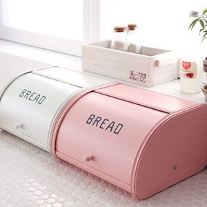 I like to think that the white one is for bread, the pink one for treats like pink iced sticky buns :)