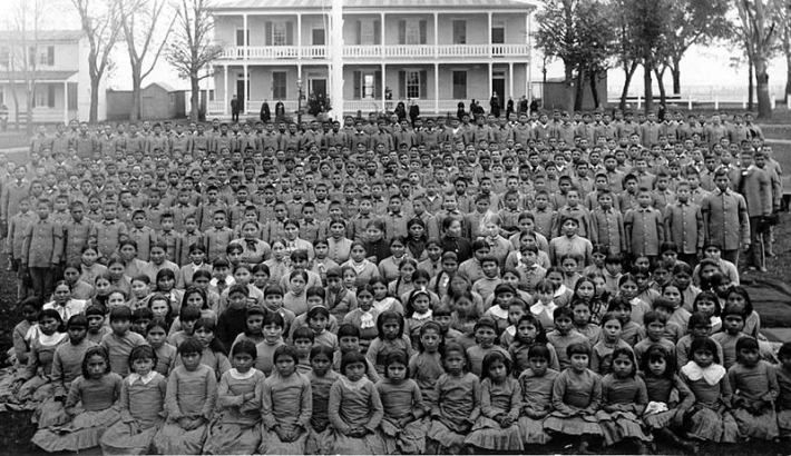 """This is probably one of the most depressingly heart-wrenching photos I've ever seen. Native American children taken from their families and put into school to assimilate them into white society. The slogan for this governmental campaign '""kill the Indian to save the man"". no official apology has ever been issued. never forgotten."" unknown"