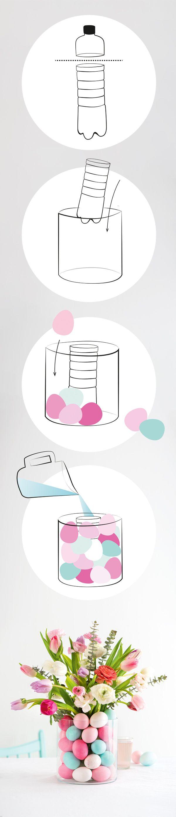 DIY Oster-Vase: Die Frühlingsblumen leuchten in einem Bett aus bunten Eiern. Die Anleitung für das Ostereier DIY findet ihr in unserem Magazin auf Seite 19.