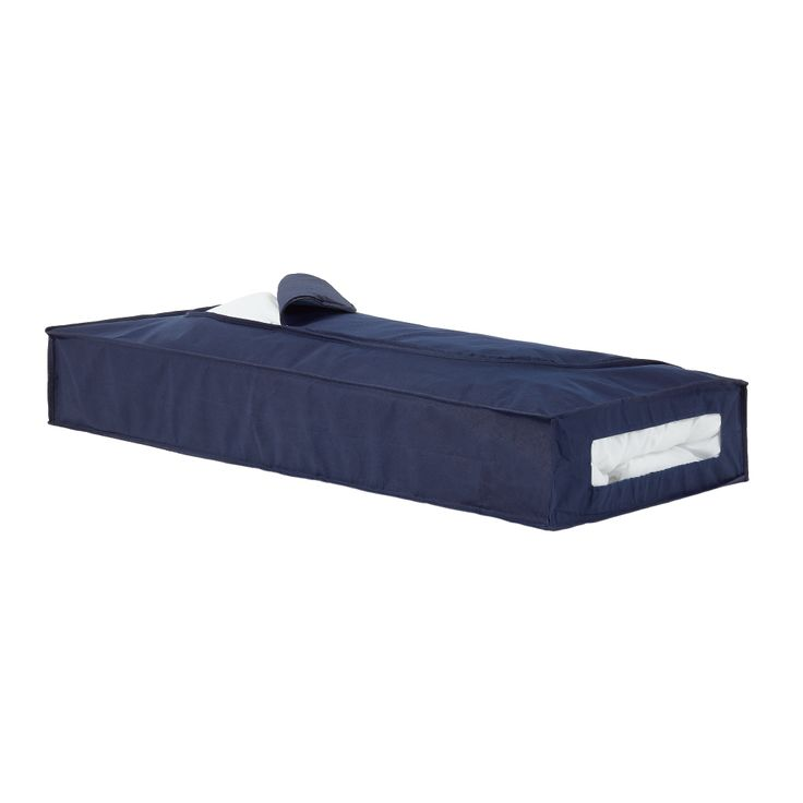 Underbed storage chest in navy blue. Space saving storage that fits neatly out of sight under bed or in the wardrobe. Ideal for storing out of season's bedding or clothing. Holds approx.: 1 double duvet or 4 pillows. Breathable and easy to wipe clean. Measures L 109cm, W 46cm, D 15cm.