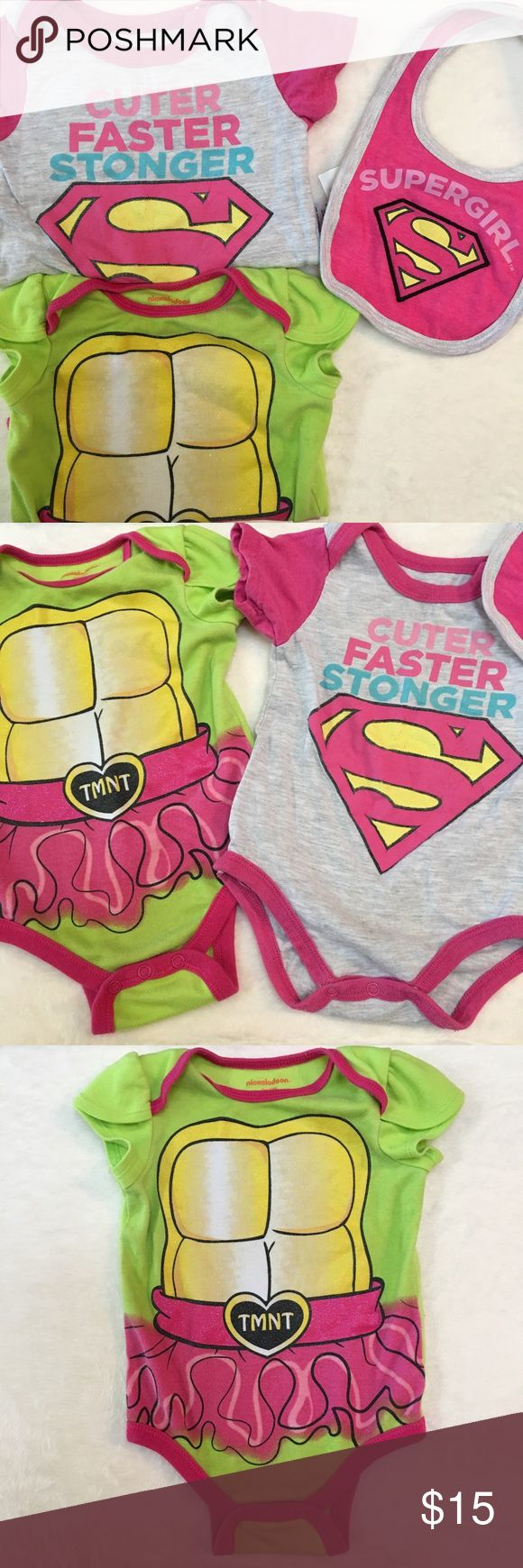 3Pcs 2 Onesies & 1 Brand New Bib Both onesies are gently used, some peeling on the supergirl logo, the supergirl also seems to be coming slightly loose on the hip, I am sure a quick needle and thread can fix it, please see pictures. Tmnt has normal wear, no damage. The bib was never used. One Pieces Bodysuits