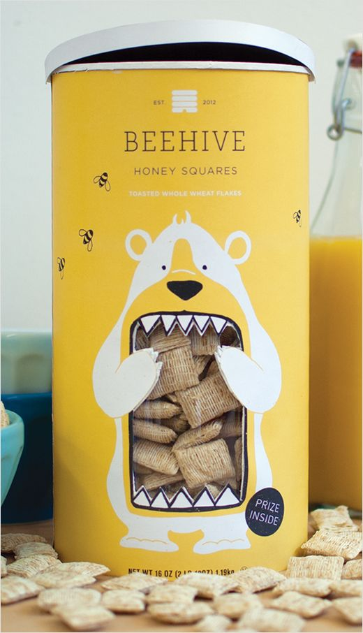 Concept Branding and Packaging: 'Beehive Honey Squares' Love the colors and cute design of the bear. The way the packaging cuts away to reveal the contents of the inside is really clever.