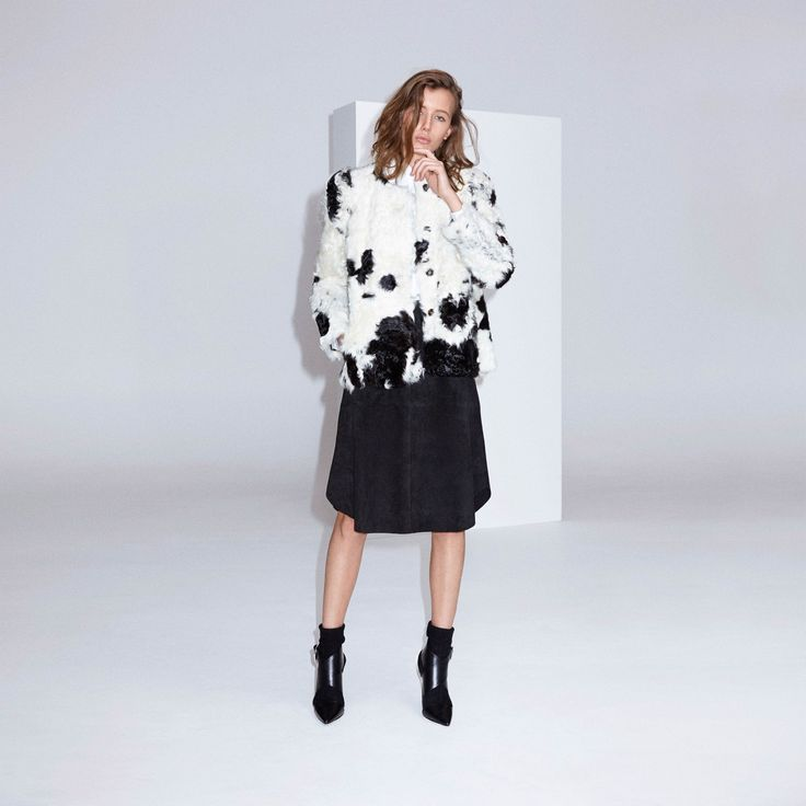 FWSS The Trip Short is a short lamb shearling jacket with press buttons at front, slit in center back, inseam pockets and leather panels on the inside of arms.
