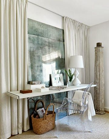 one way to deal with a windowless wall; faux view on blank wall; panels and antiqued mirror;