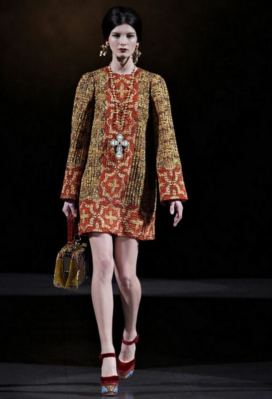 Dolce & Gabbana Winter 2014. wow. same style as the mini i wore as my wedding dress  -- it was white wool with bands of black and white geometric pattern that crossed the front with bands around wrists and hemline!
