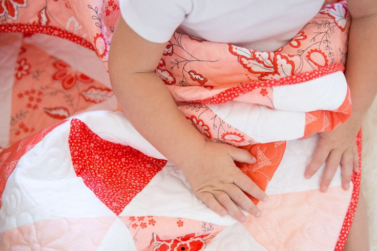 Modern triangle baby quilt in peaches and corals.  Perfect for any little girl.