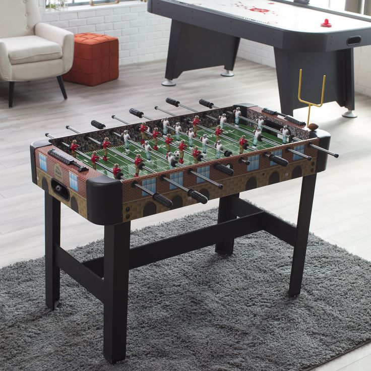 Voit Football Stadium 48 in. Foosball Table - With the look of a real football stadium, inside and out, the Voit Football Stadium 48 in. Foosball Table features highly detailed, full-color graphic...