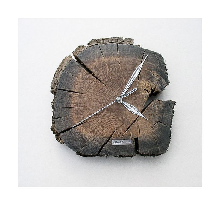 Model no 12. This clock is made of construction wood from the buildings of the Old Town of Gdansk. Black oak dating back to the 14th century. Size 20 cm x 20 cm.
