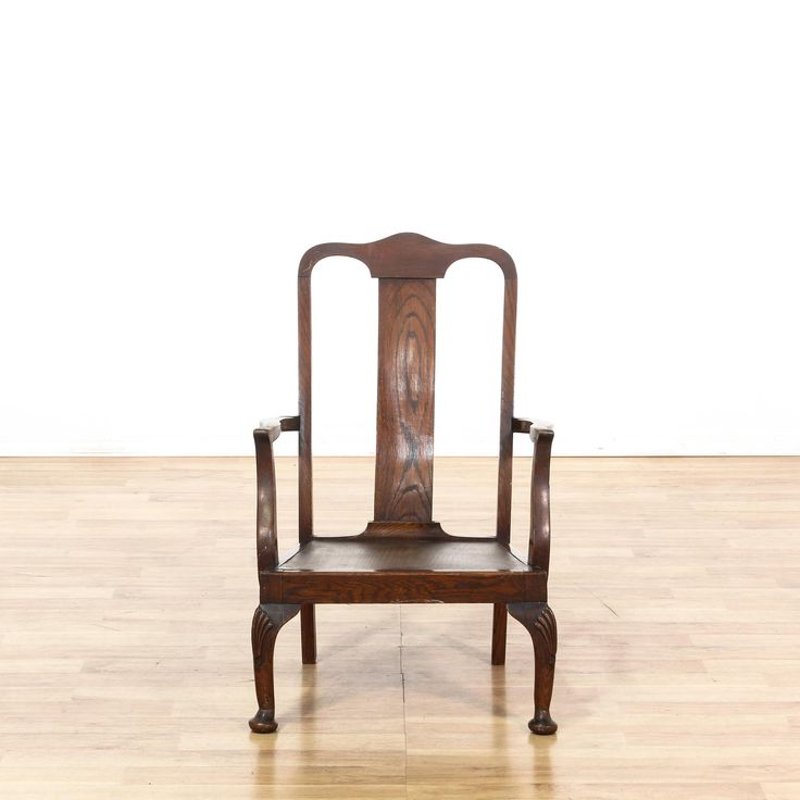 This accent chair is featured in a solid wood with a glossy walnut finish. This Asian style chair has claw-and-ball feet, slightly curved back, and carved accents. Perfect for the living room! #asian #chairs #accentchair #sandiegovintage #vintagefurniture
