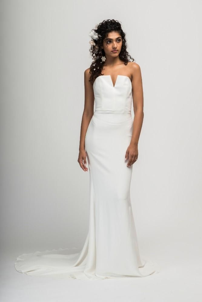 d9bb769030 This strapless gown is made of silk crepe and features a structured