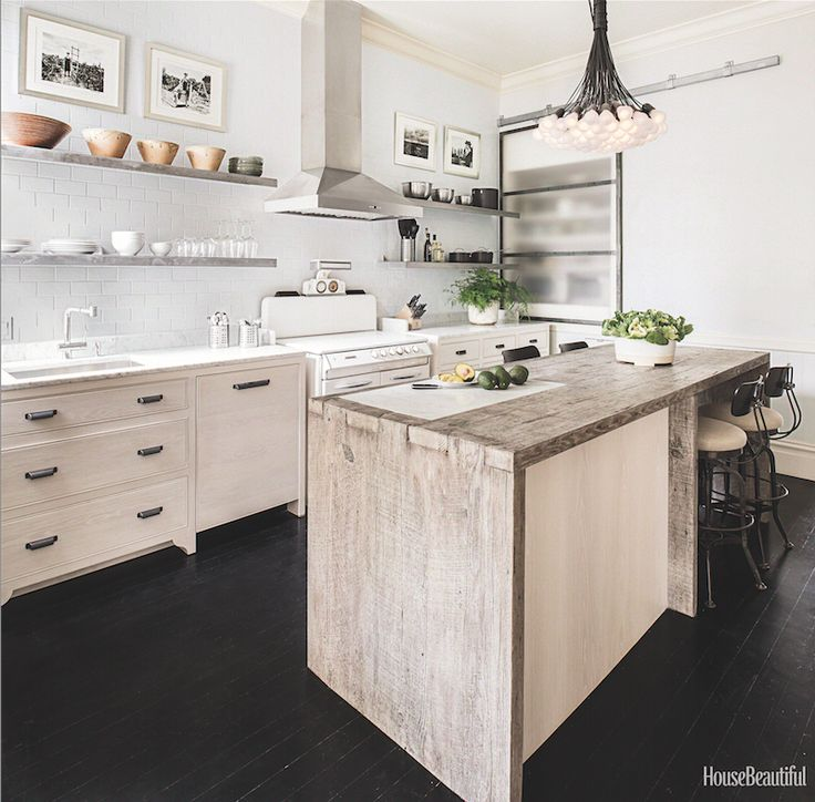 1896 Victorian Kitchen - Old-fashioned cabinets and a barnwood island blend with modern elements like cantilevered metal shelves and a chandelier made of 85 bulbs tied together.