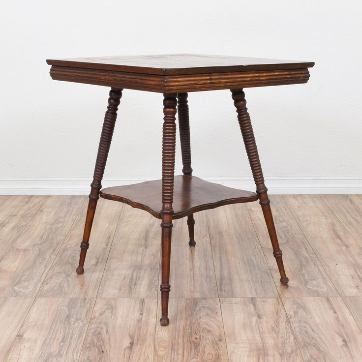 this tall end table is featured in a solid wood with a glossy rustic dark cherry