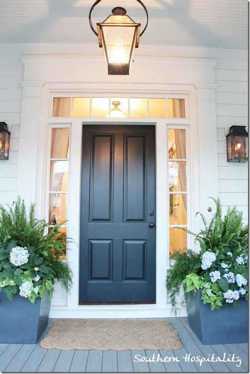 those planters!!!  and the solid door with 3/4 sidelights