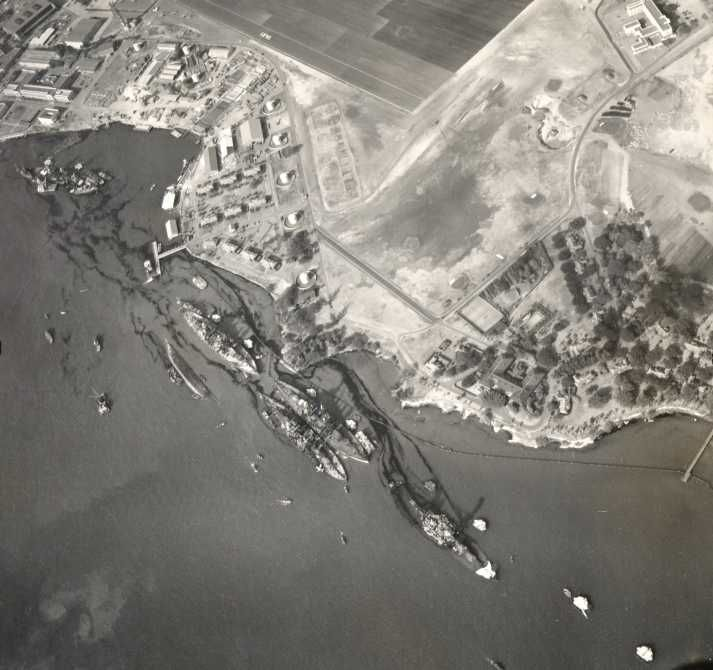 The japanese bomb and destroyed the pearl harbor so bad that it was harley nothing left, this is a picture taken of it being destroyed