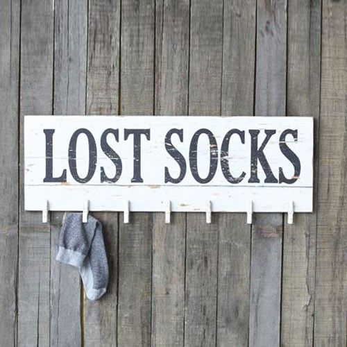 DIY inspiration-Don't let the dryer win, keep tabs on your lost socks with this charmingly rustic plaque. It has pins for up to 7 single socks for a sure shot at making a match.