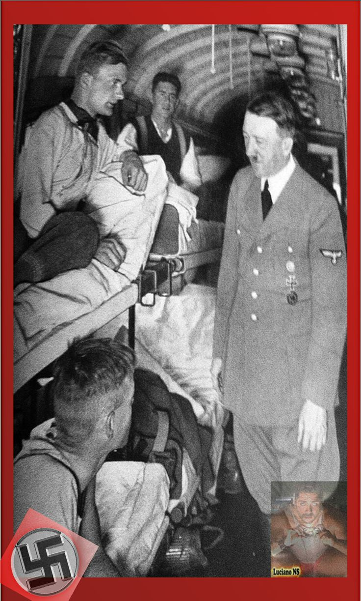 Mr. Adolf Hitler visiting wounded soldiers, showing his great humanity.  Herr Adolf Hitler Besuch verwundete Soldaten, zeigt seine große Menschlichkeit.