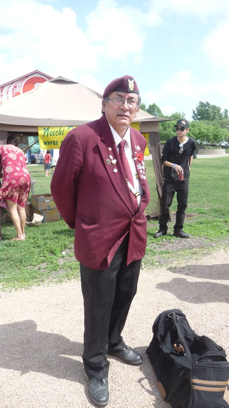 Aboriginal war veteran at Aboriginal Day Live 2013 showcasing his outfit with his medals he was awarded peacetime keeping.