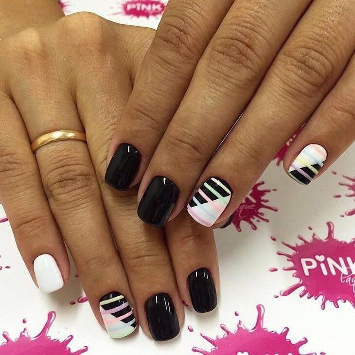 In this photo you can see a classical black white combination of colors on the nails! But it is added