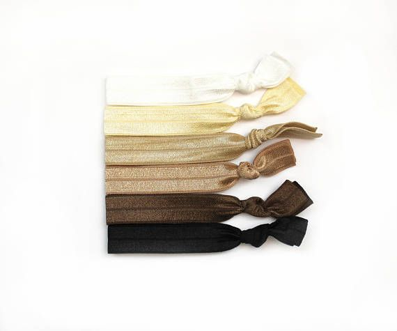 Neutrals Elastic Hair Tie Package  This package Includes: ♥ one black hair tie ♥ one brown hair tie ♥ one nude hair tie ♥ one tan hair tie ♥ one cream hair tie ♥ one white hair tie  These gentle stretchy hair ties wont crease most hair and can also be worn as stylish bracelets. Perfect as