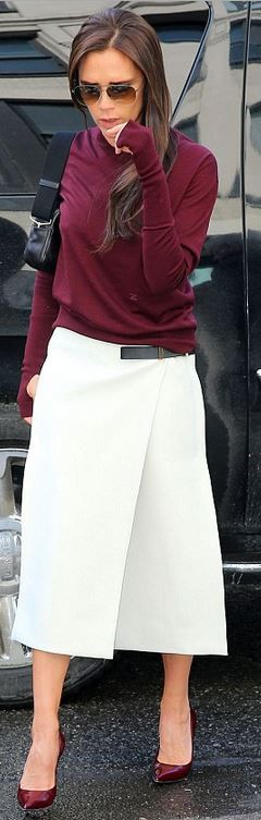 Victoria Beckham rocks low-key rouge jumper and a white skirt at NYFW
