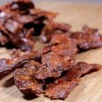 Pig candy (sweet bacon) is nothing new but it does take things up about 5000 notches when you make it in the smoker. You'll love this smoked bourbon pig candy.