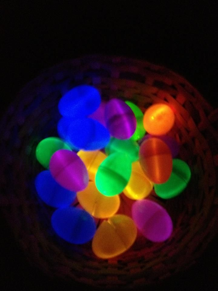 Illuminated Easter eggs - friend made these out of plastic eggs with glow sticks curled up inside!