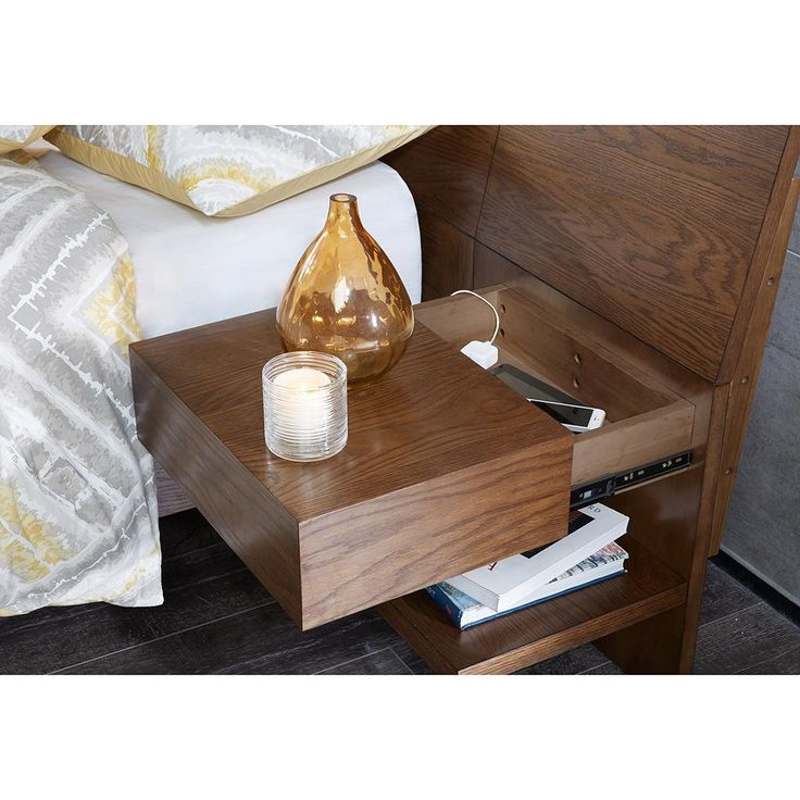 Form follows function in our sleek bedroom set that comes complete with 2 attached nightstands. Cantilevered nightstand boxes slide forward to reveal hidden sto