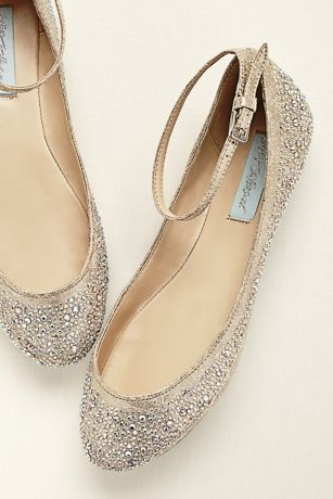 This sparkling crystal encrusted ballet flat by Betsey Johnson proves that you never need to sacrifice style for comfort!  Ballet flat features ankle strap for a secure fit and is embellished with all-over high shine crystals.  Heel height: Flat.  Fully lined.  Imported.