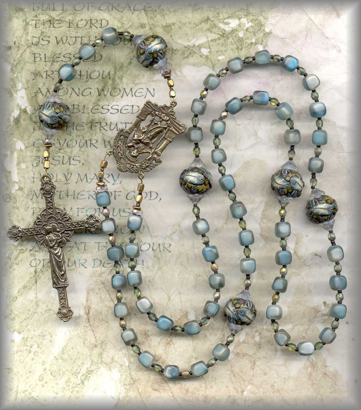A friend has asked me to help her make a rosary for her mother...so I did a little research.  this one caught my eye during my search.