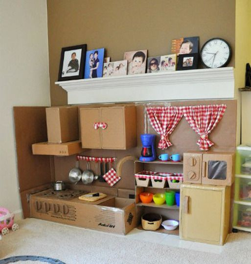 Awesome home-made cardboard play kitchen. Beats bringing more plastic into the world.